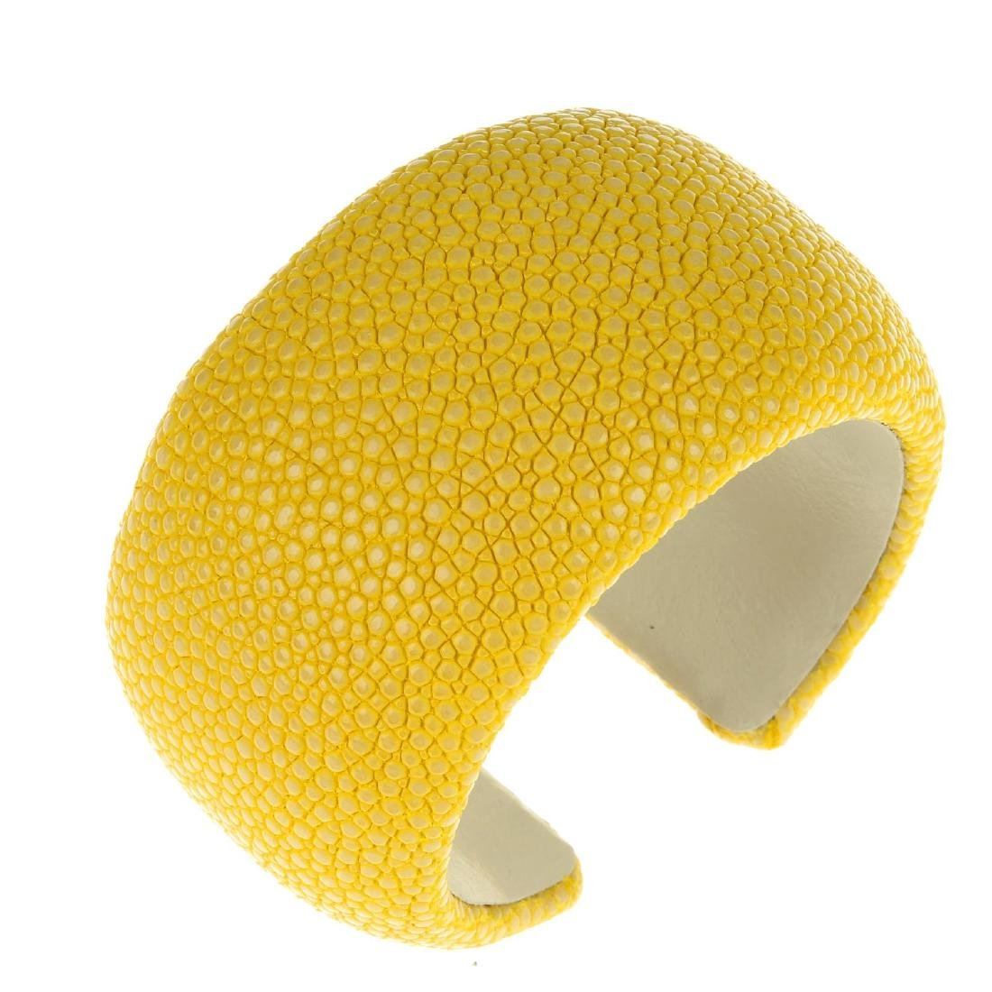 A stingray cuff. The yellow stingray to the outer