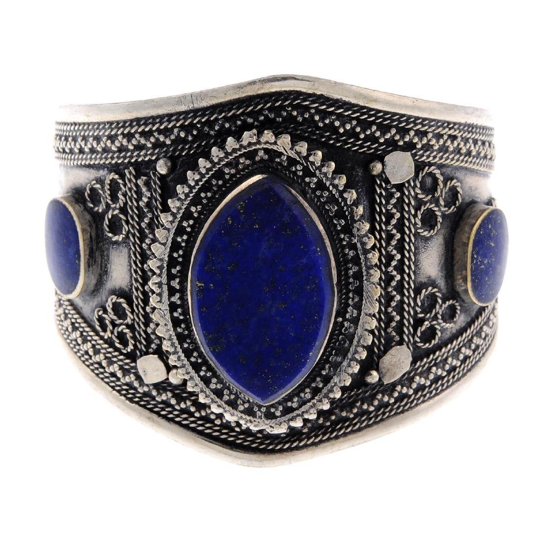 A lapis lazuli bangle. The open bangle of tapered