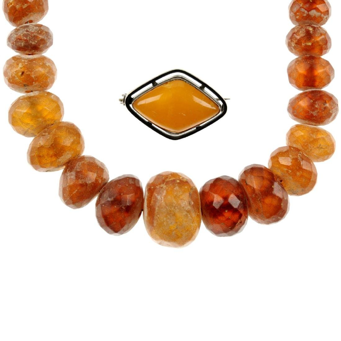 A selection of gem jewellery. To include a necklace,