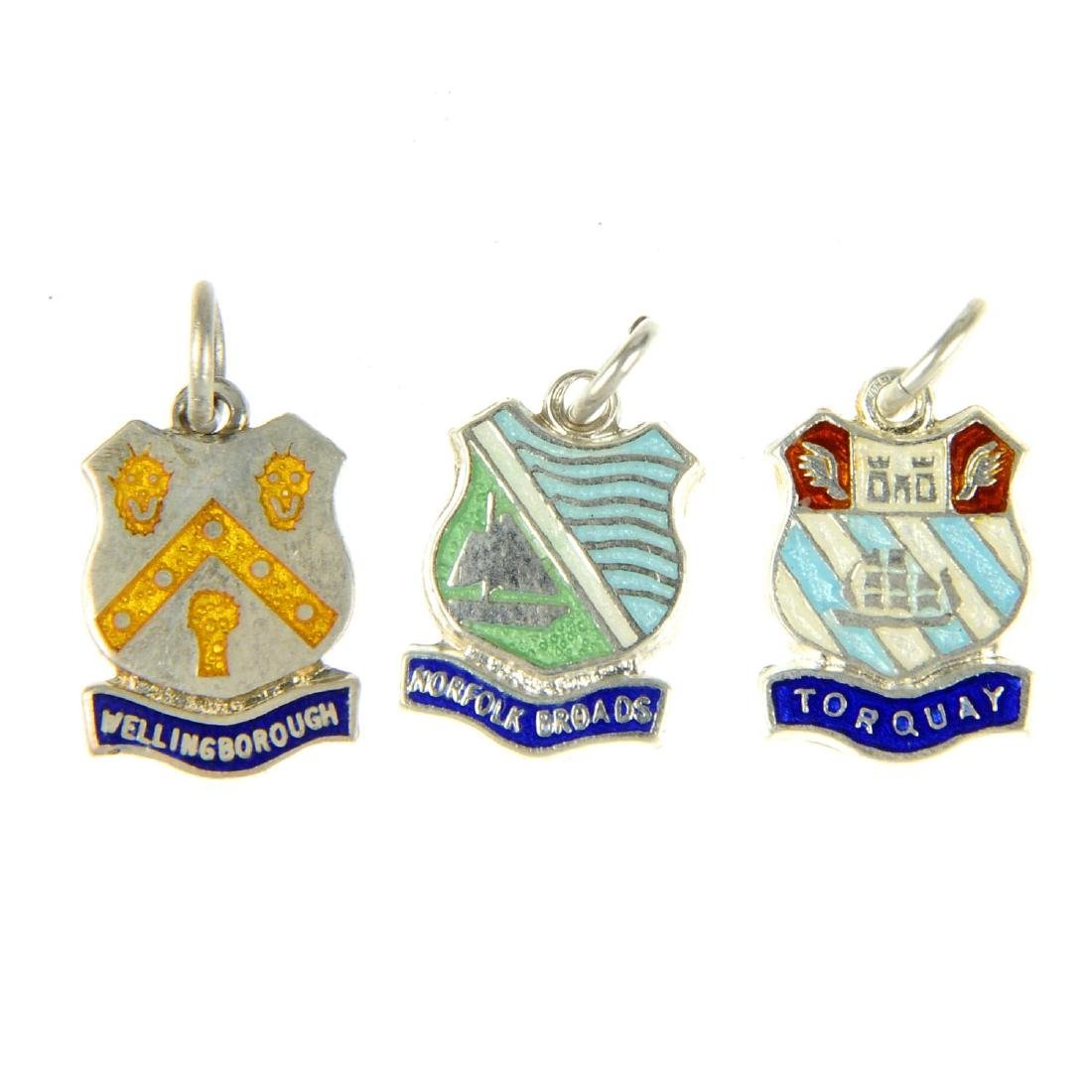 A selection of enamel town charms. To include town
