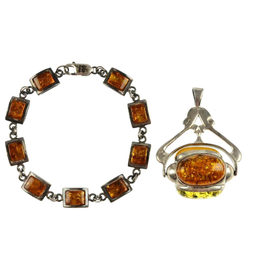 A selection of mainly modified amber jewellery in
