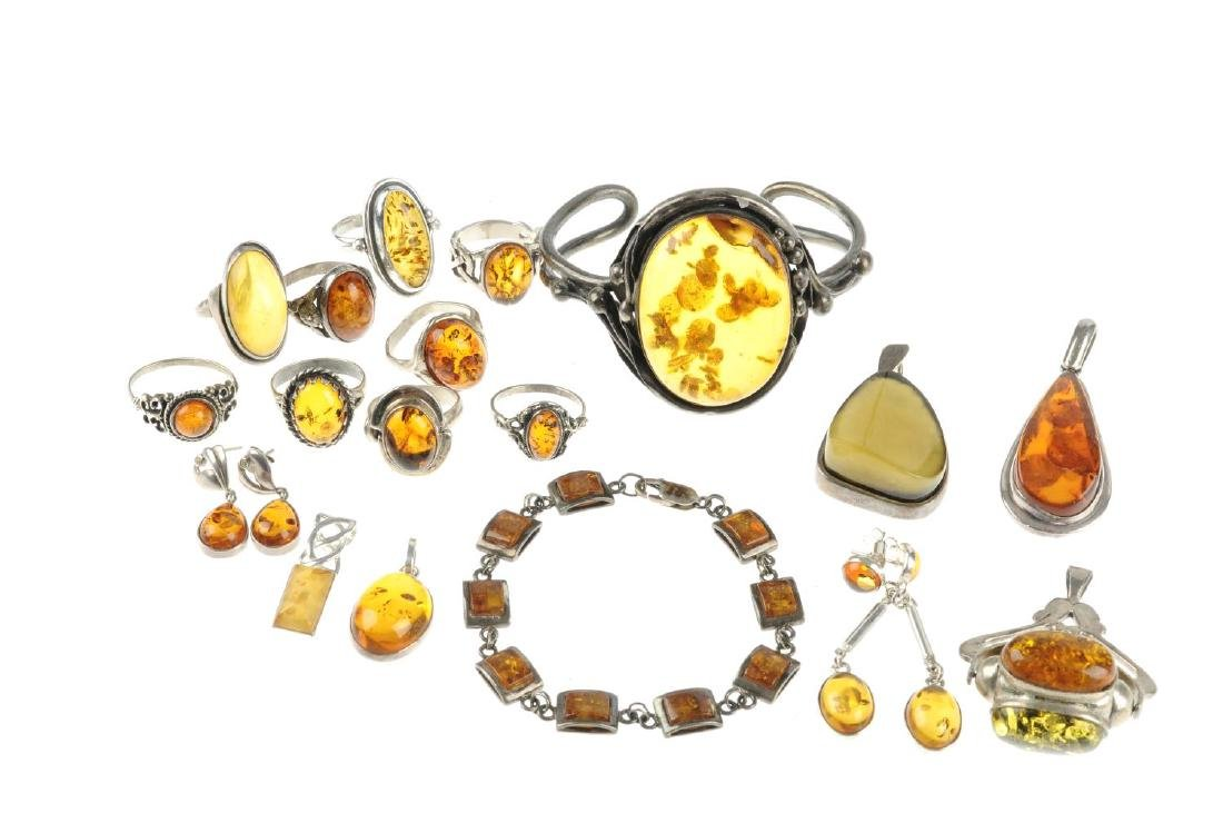 A selection of mainly modified amber jewellery in - 2