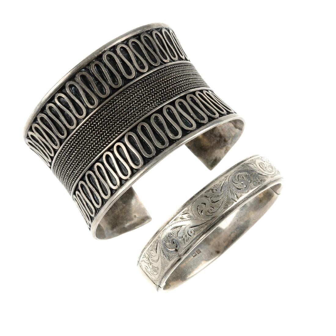 A selection of silver and white metal bangles. To