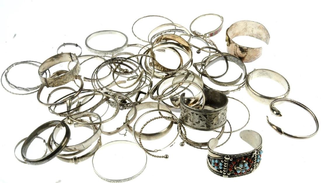 A selection of silver and white metal bangles. To - 2