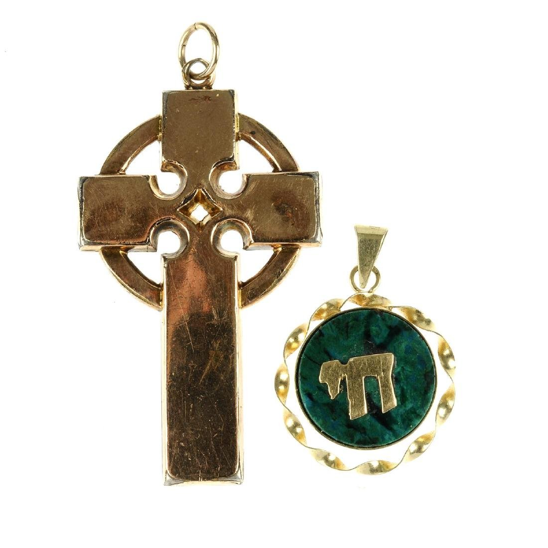 A watch, a cross and a gem pendant. The watch by