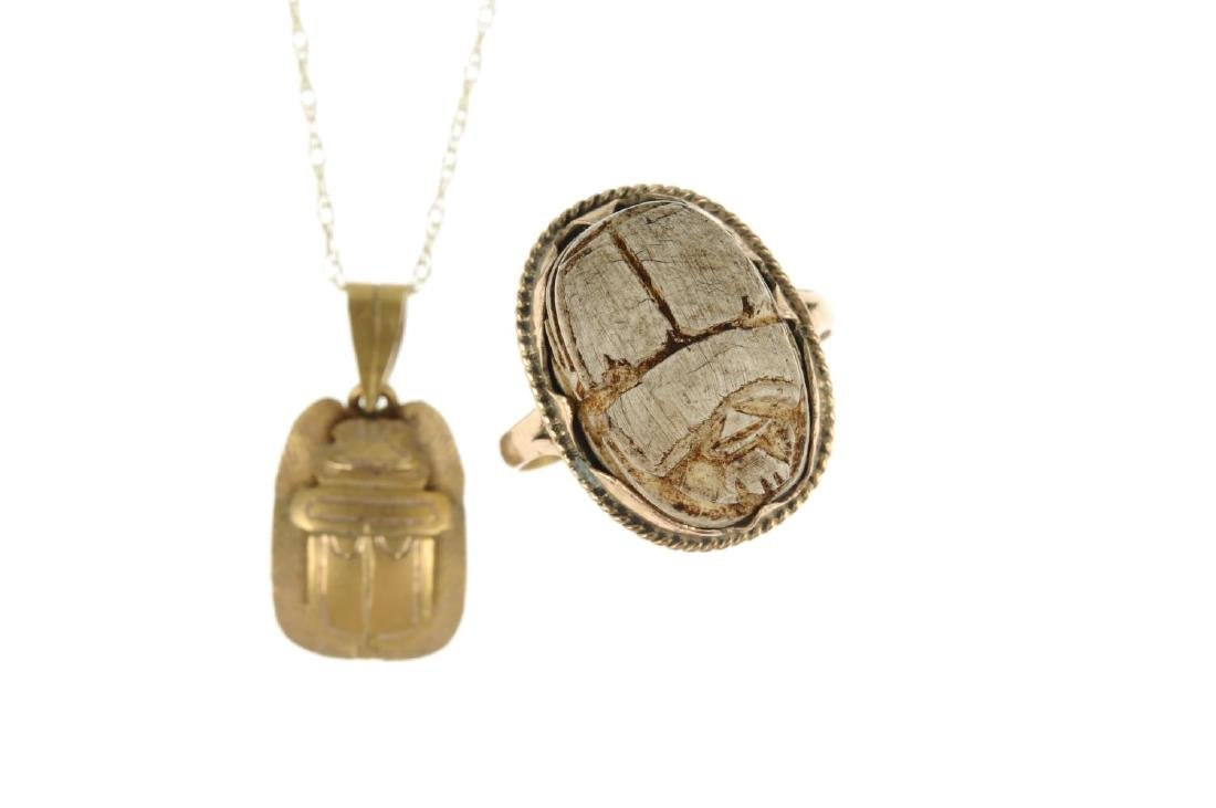 A scarab ring, pendant, cufflink and keyring. The ring