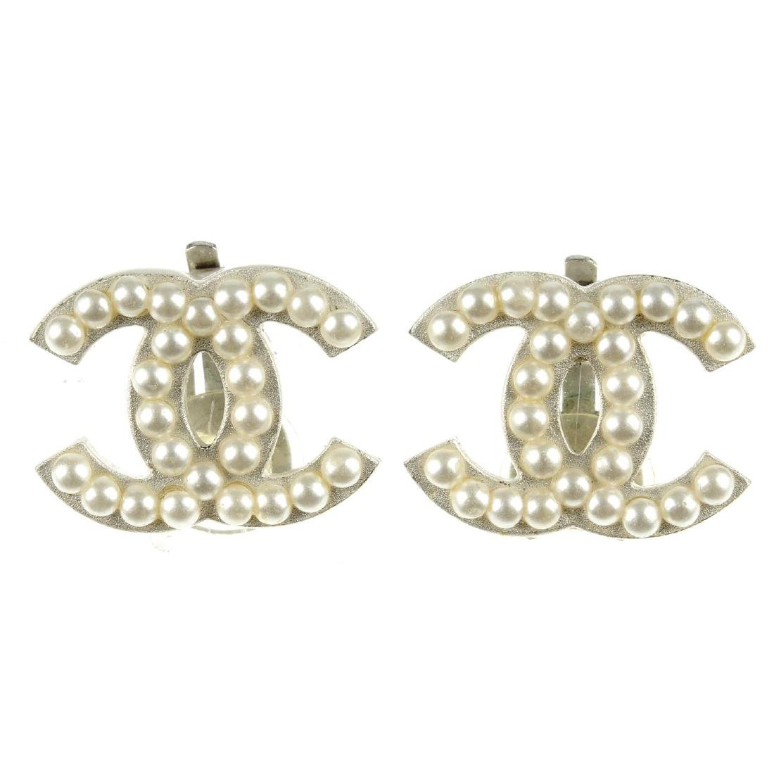 CHANEL - a pair of earrings. Each designed as two