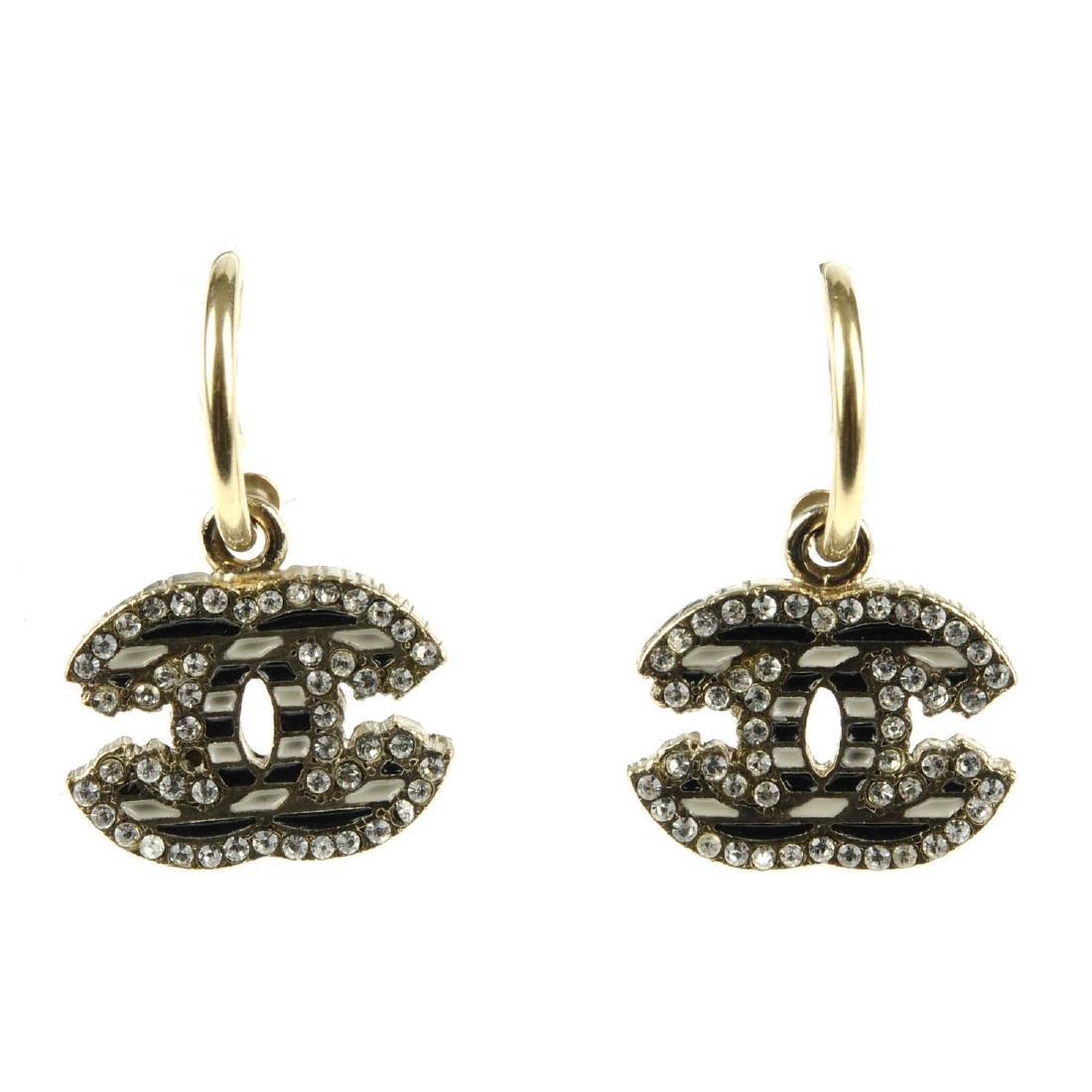 CHANEL - a pair of earrings. Designed as hoops,