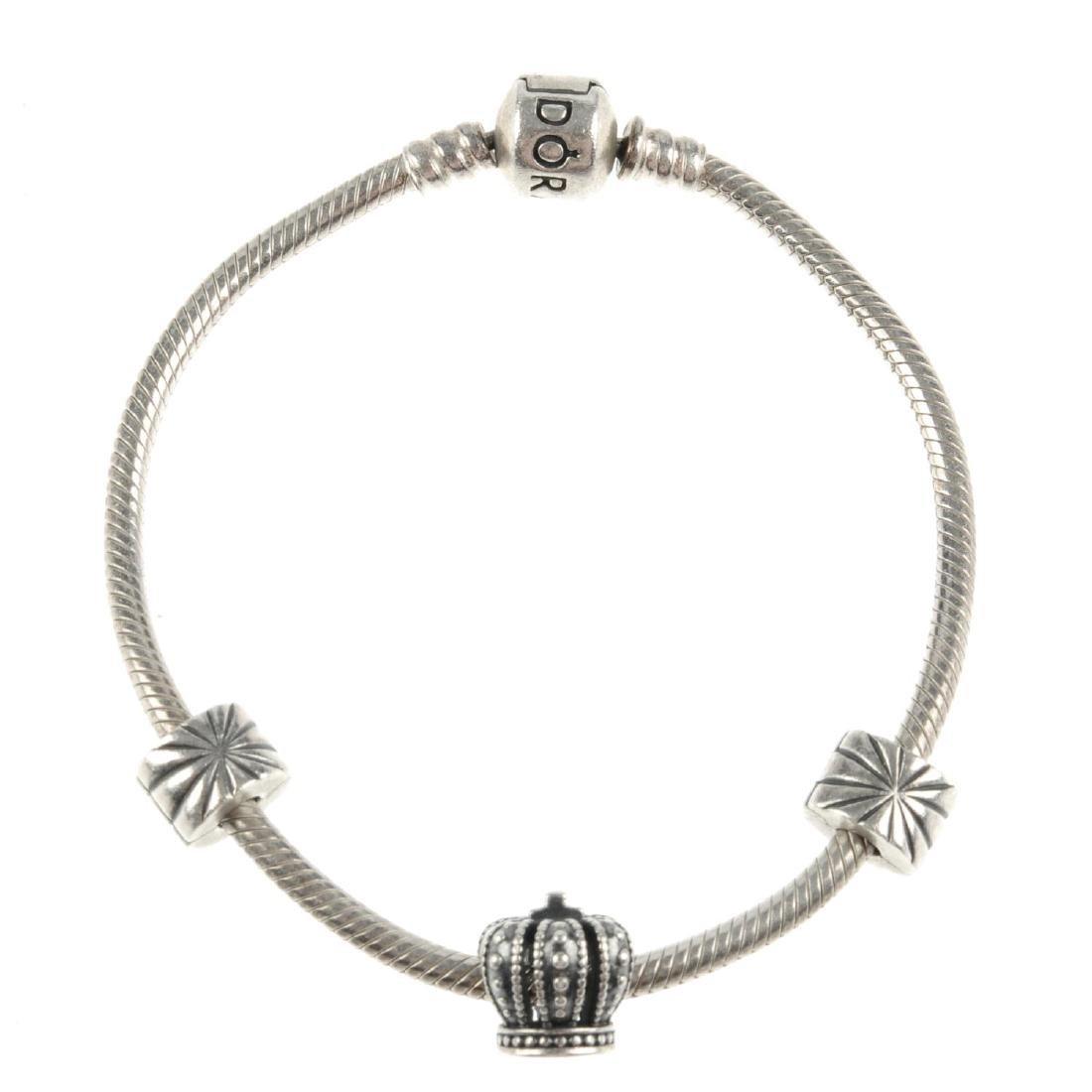 PANDORA - a charm bracelet. The bracelet with