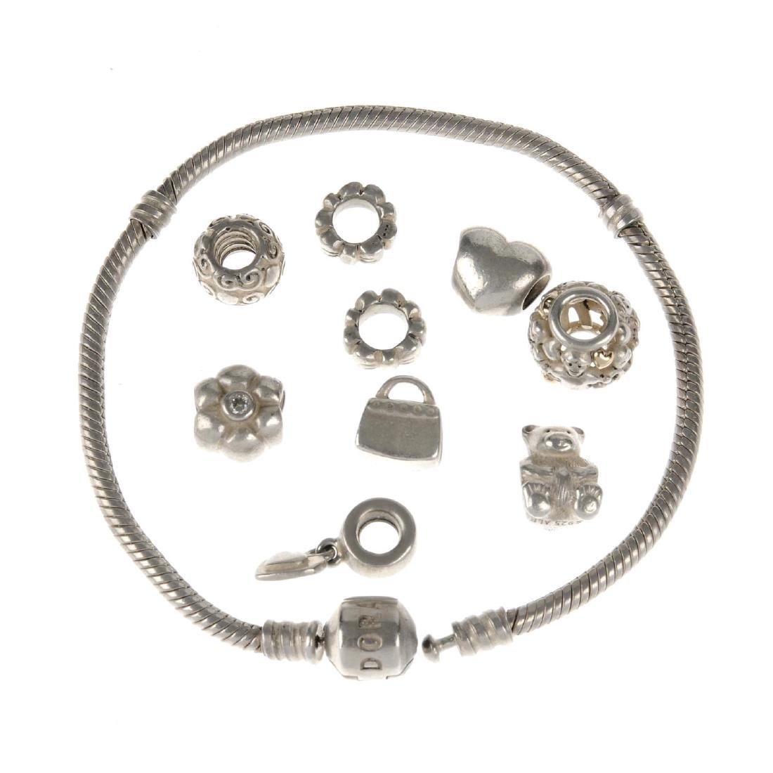 PANDORA - two charm bracelets, nine Pandora charms and