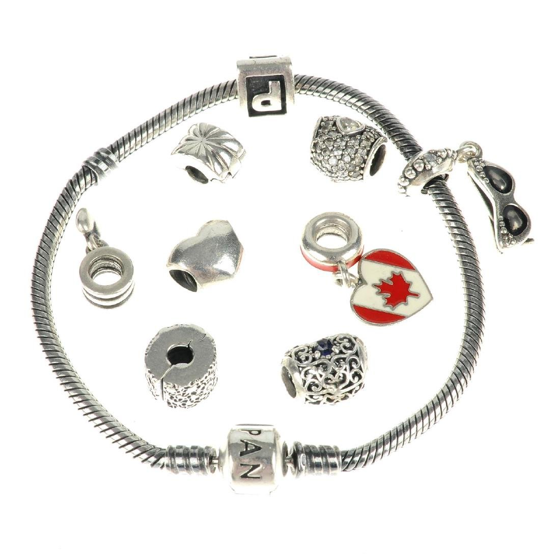 PANDORA - two charm bracelets and a total of eighteen