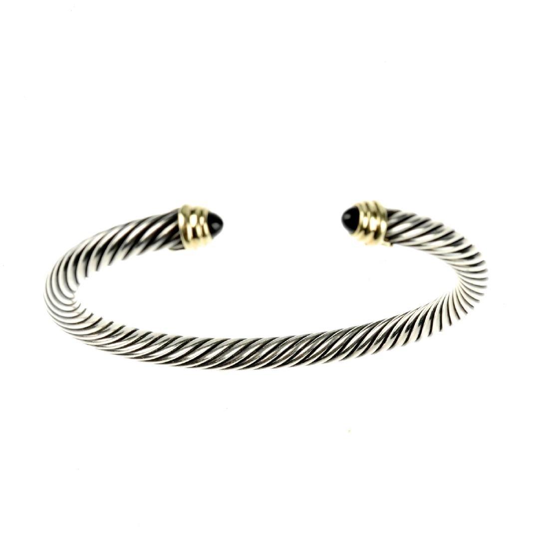 DAVID YURMAN - a gem-set bangle. A torque style bangle