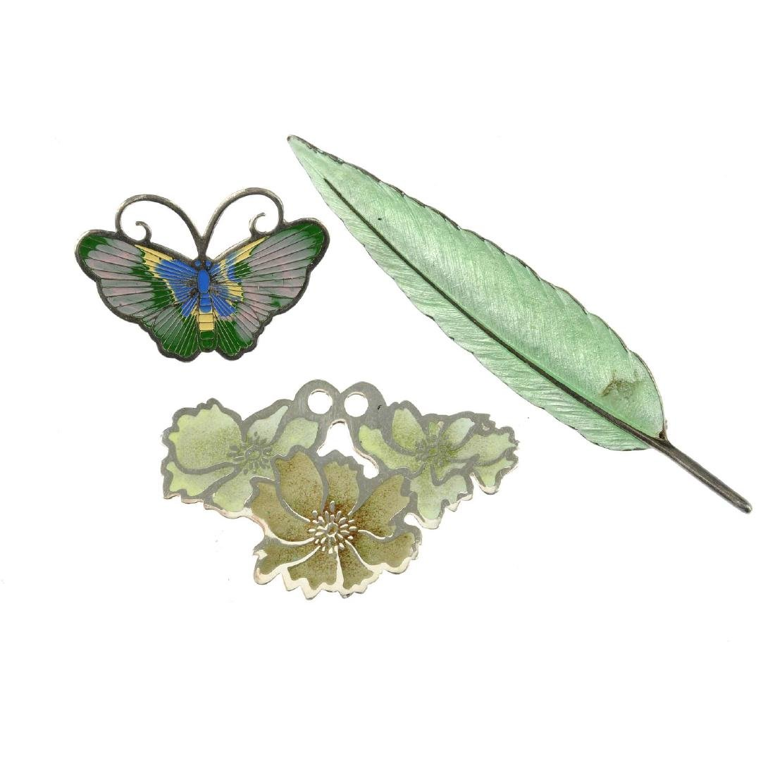 A selection of enamel jewellery. To include a green