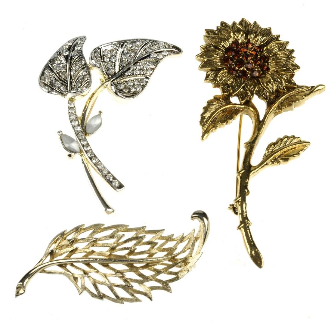 A selection of brooches and earrings. To include a