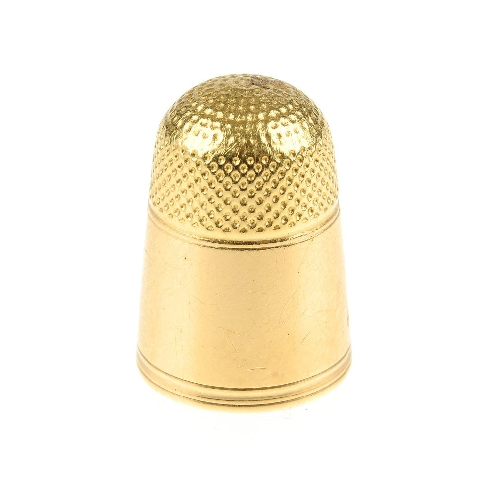 An early 20th century gold thimble, with case. The