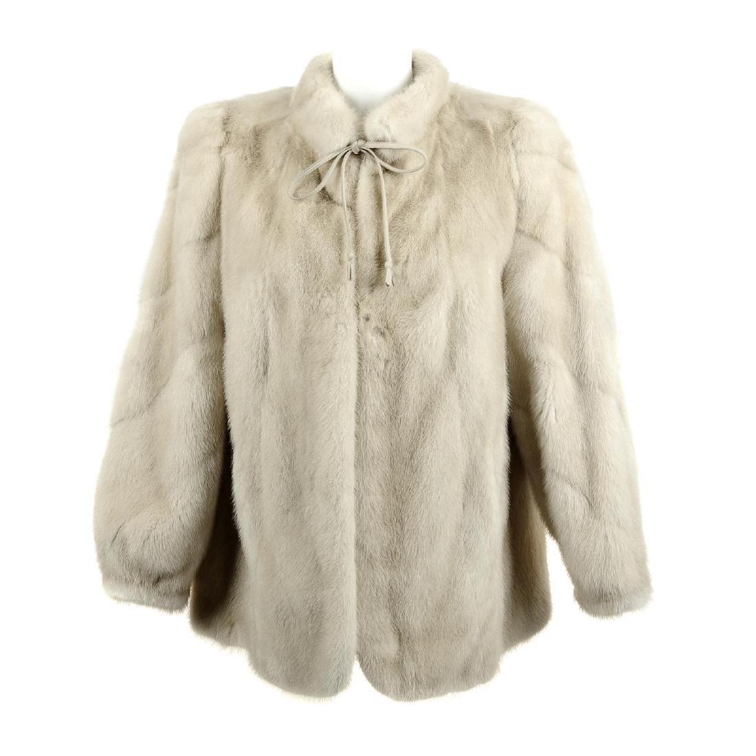 A tourmaline mink jacket. Featuring a Mandarin collar