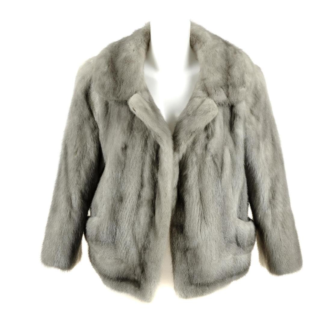 A sapphire mink jacket. The open front jacket designed