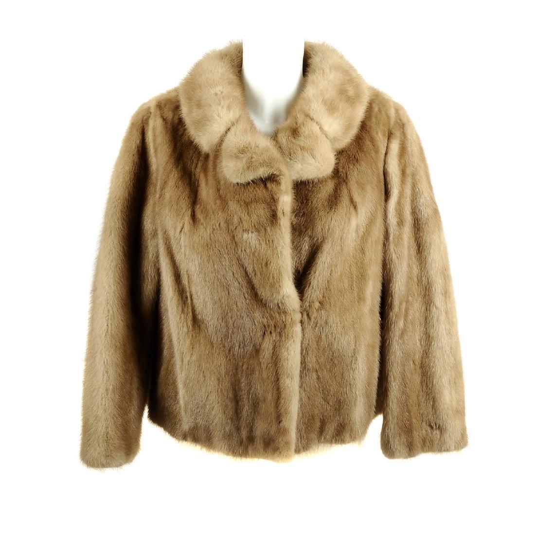 A mink fur jacket. Designed with a notched lapel
