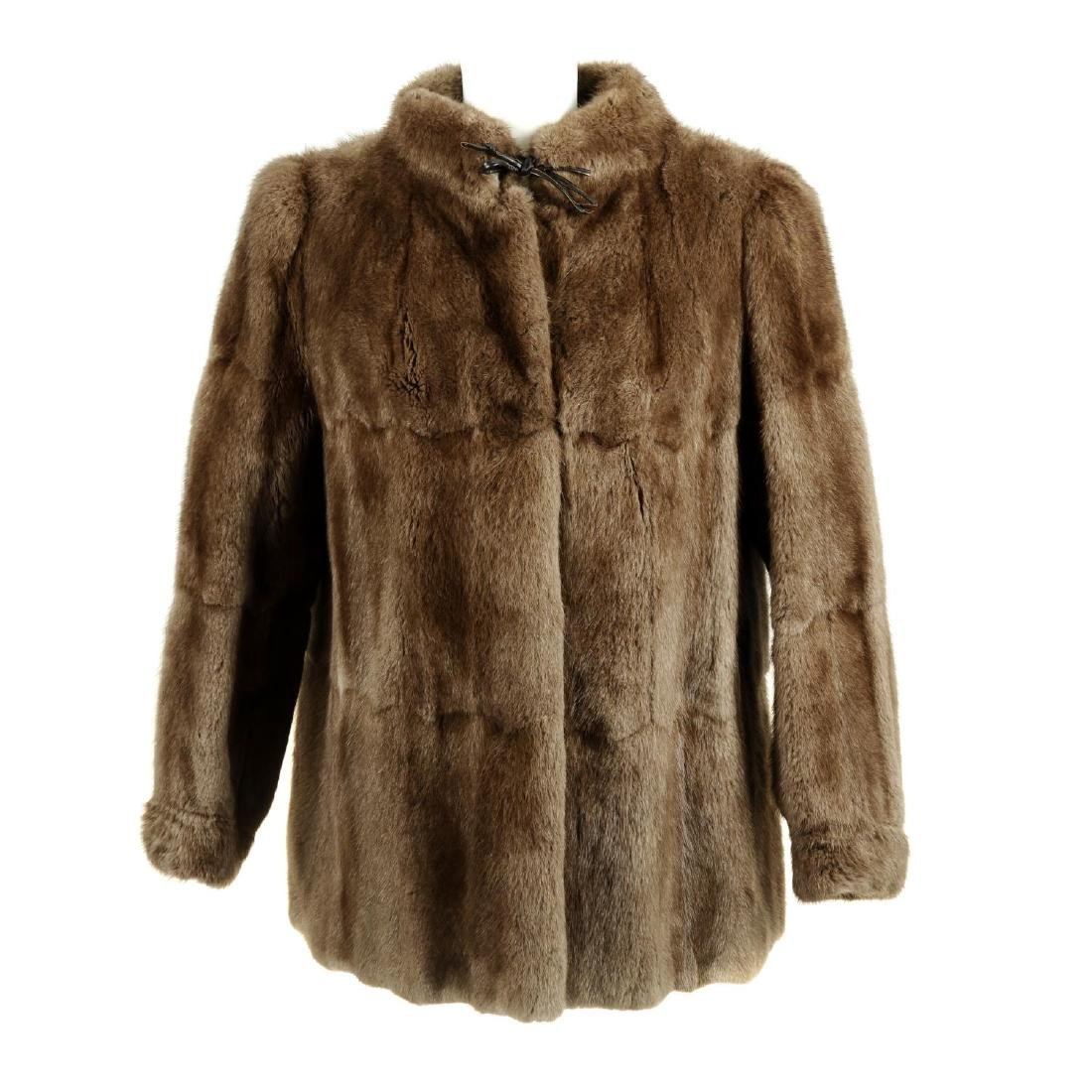 A mink fur jacket. Featuring a Mandarin collar, hook