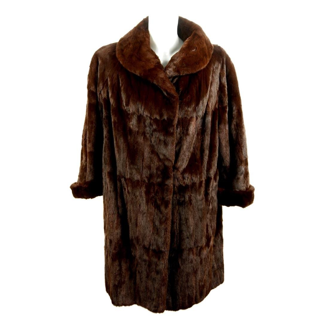 A mink fur stole and a squirrel fur coat. To include a