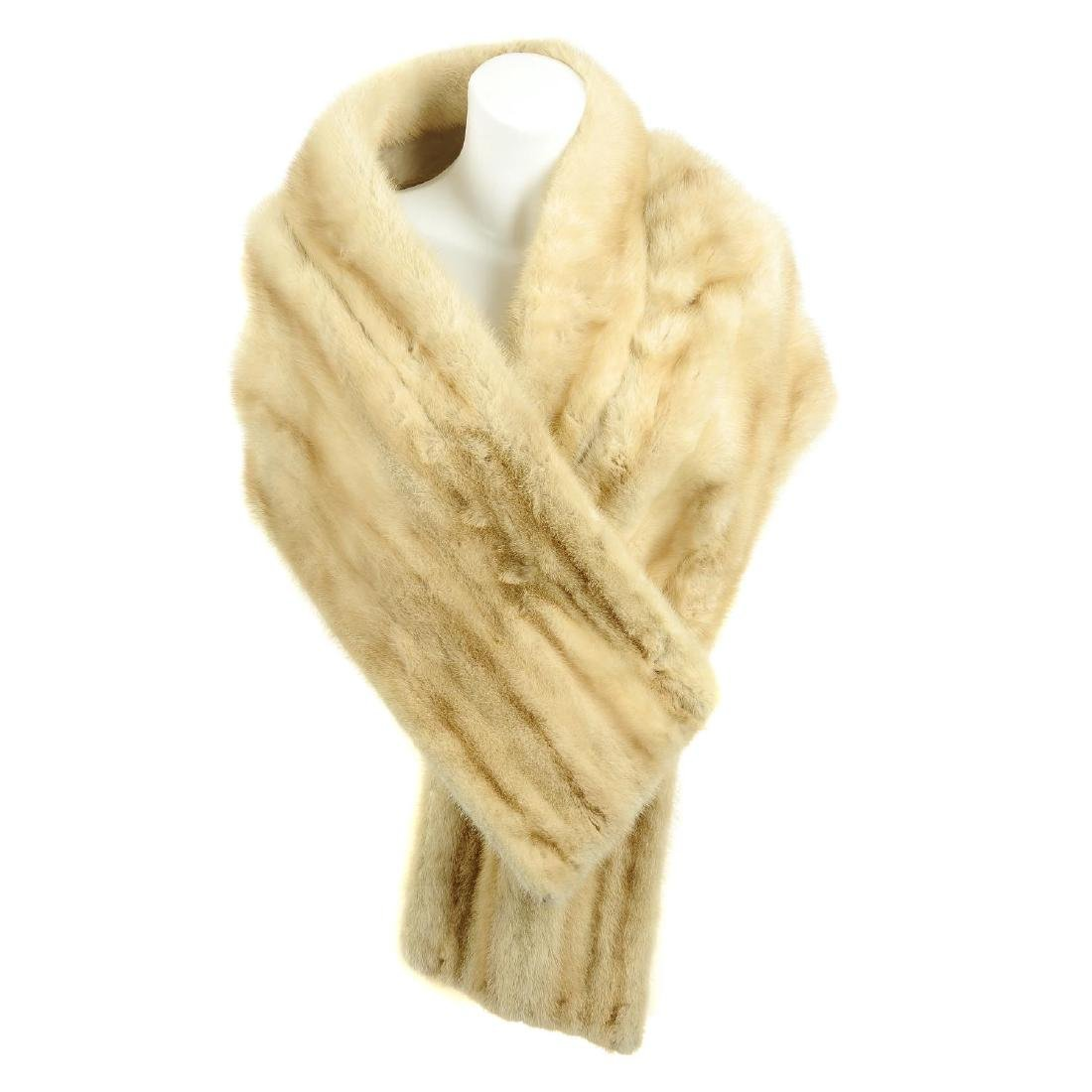 A mink stole and musquash stole. Both stoles designed