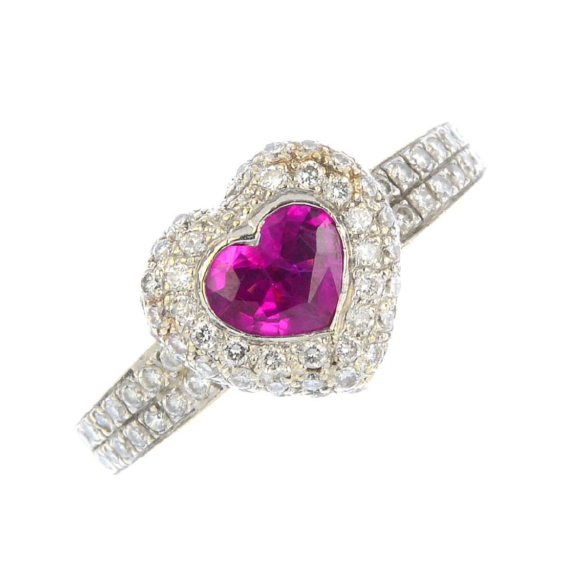 A ruby and diamond cluster ring. The heart-shape ruby,