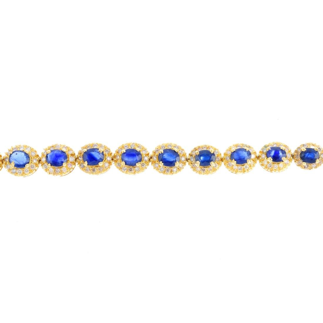 A sapphire and diamond bracelet. Comprising a series of