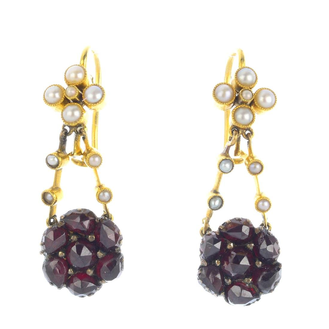 A pair of foil-backed garnet and seed pearl earrings.