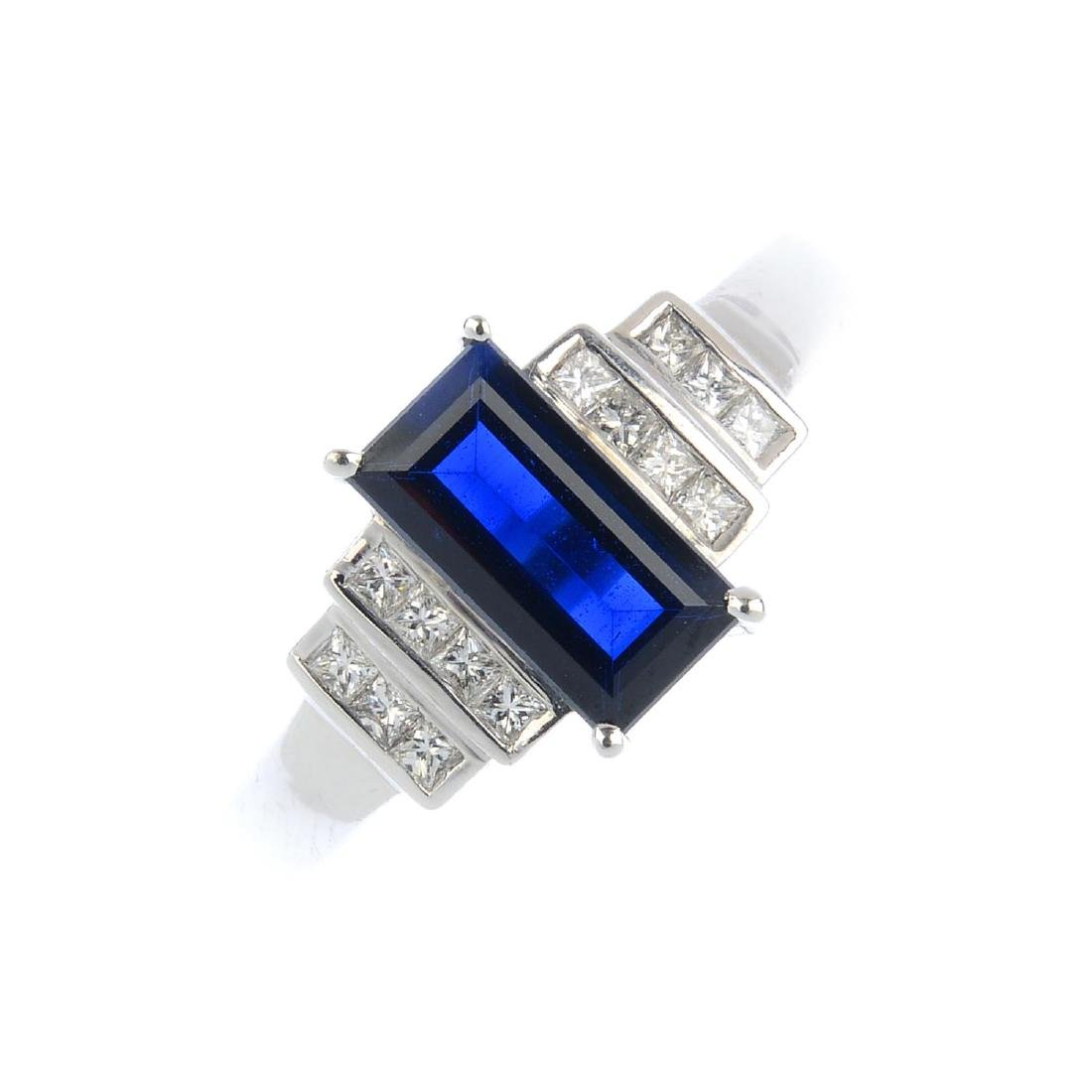 An 18ct gold sapphire and diamond dress ring. The