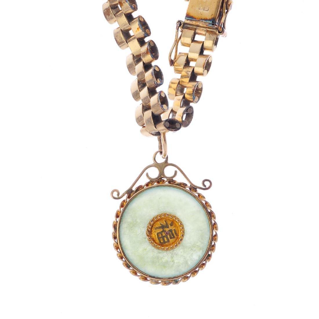 A jade bi charm bracelet. Designed as a jadeite bi,