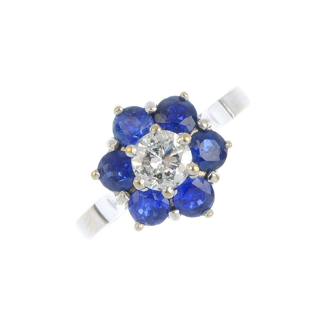 A sapphire and diamond cluster ring. The brilliant-cut