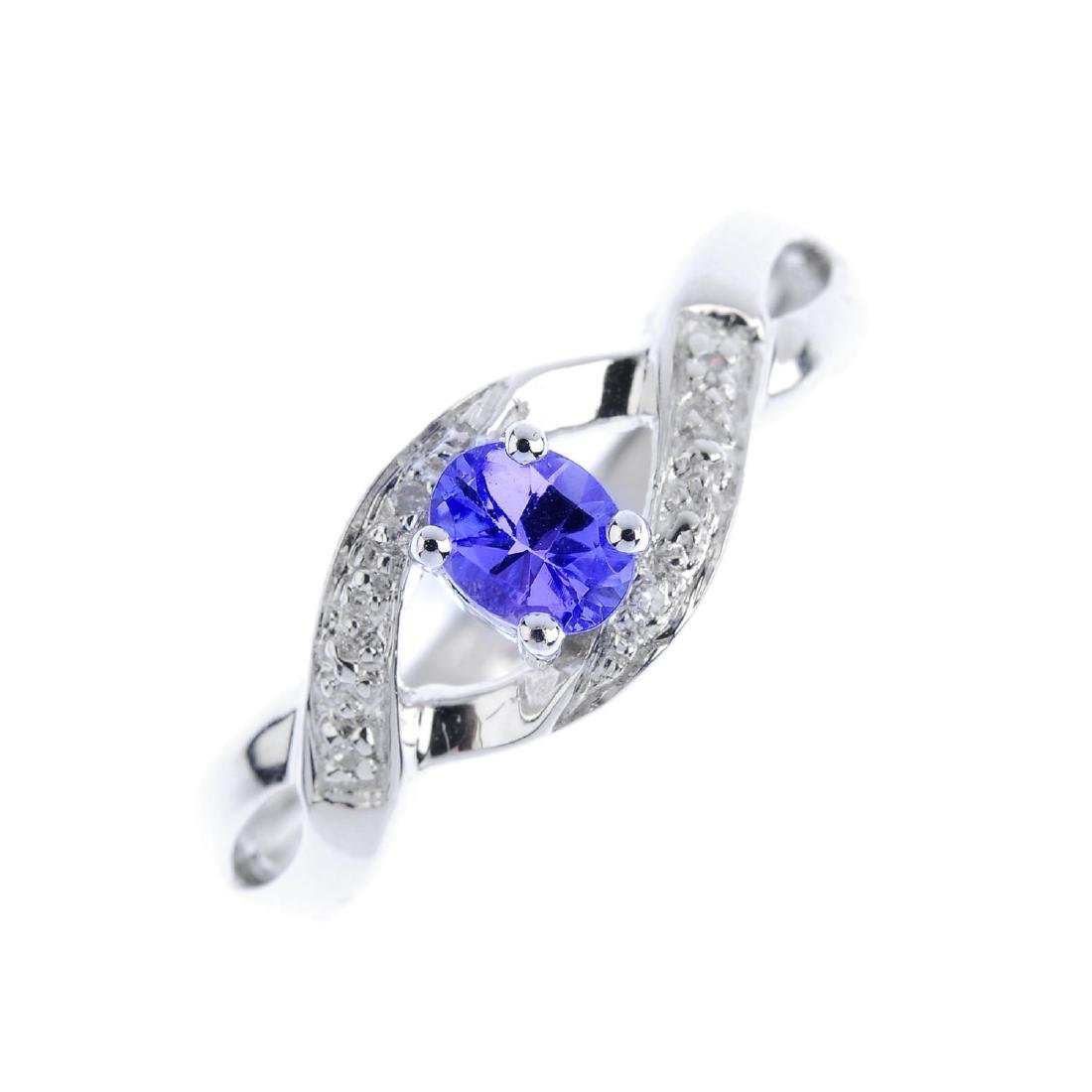 A 9ct gold tanzanite and diamond crossover ring. The