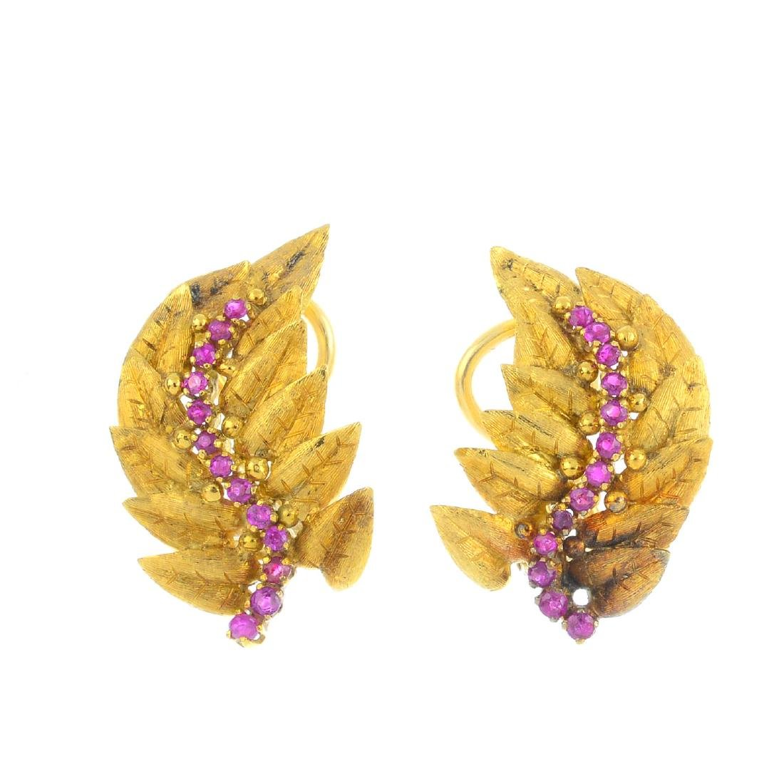 A pair of ruby earrings. Each designed as a series of
