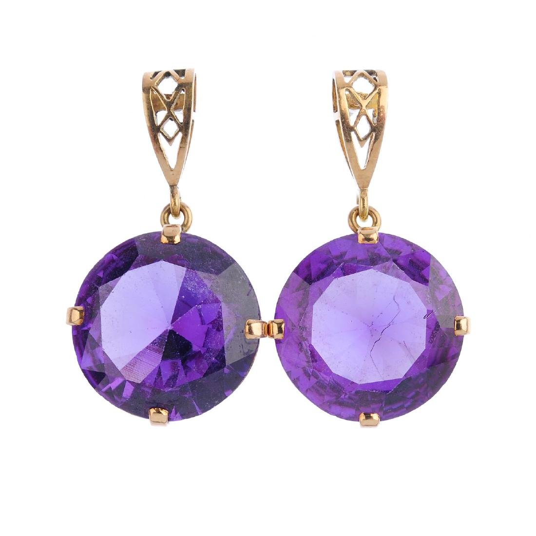 A pair of synthetic sapphire earrings. Each designed as