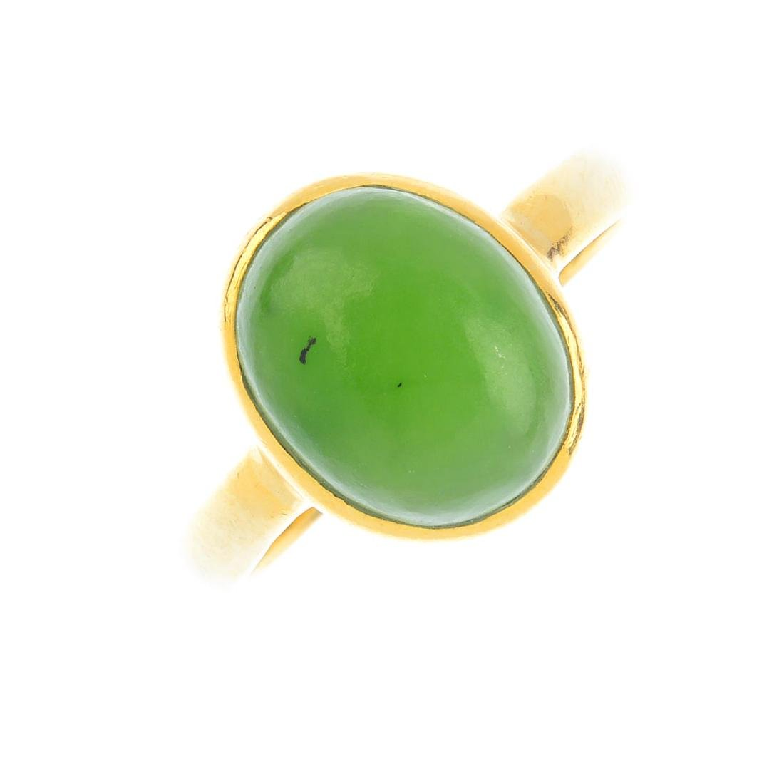 A jade single-stone ring. The oval nephrite cabochon