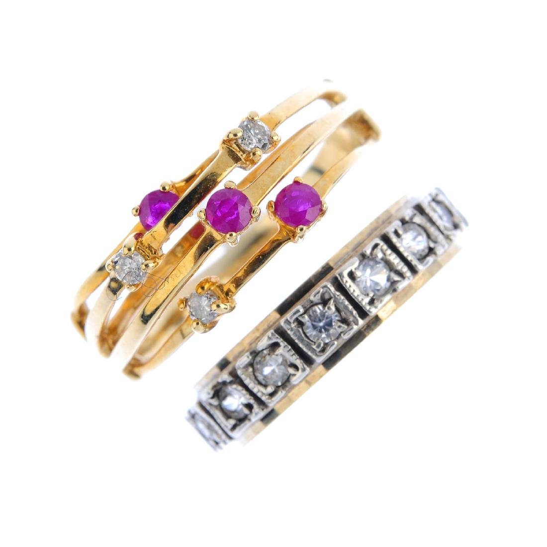 Four gem-set rings. To include a ruby and diamond dress