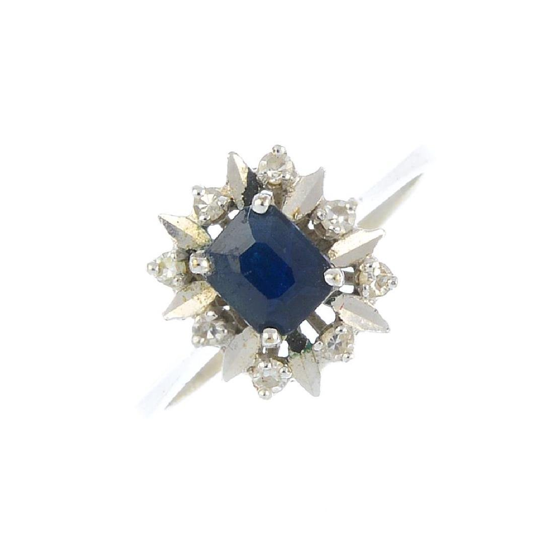 A sapphire and diamond cluster ring. The