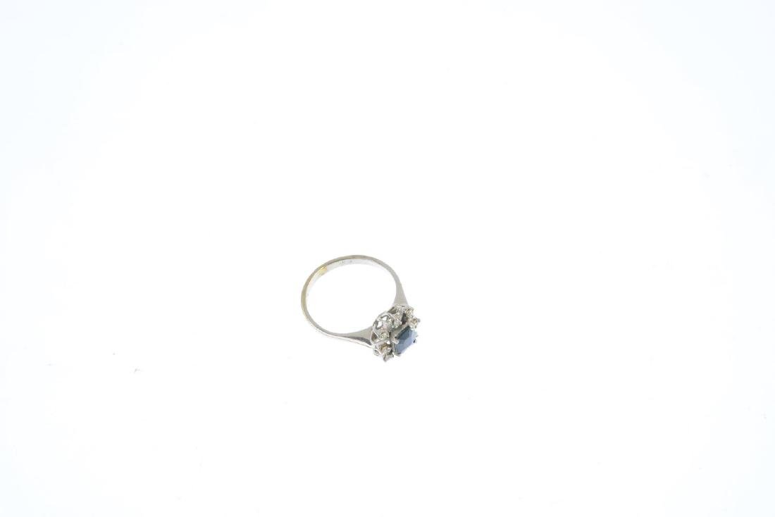 A sapphire and diamond cluster ring. The - 4
