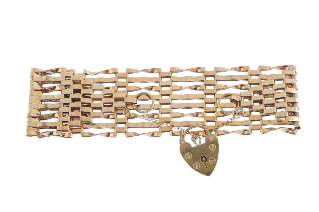 A 1970s 9ct gold gate bracelet. Designed as a series of