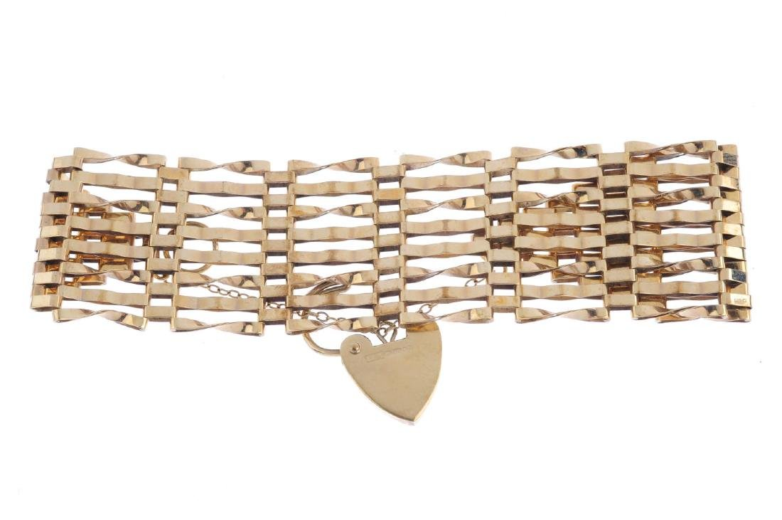 A 1970s 9ct gold gate bracelet. Designed as a series of - 2