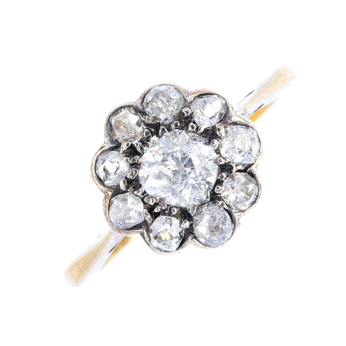 A diamond cluster ring. The old-cut diamond, with
