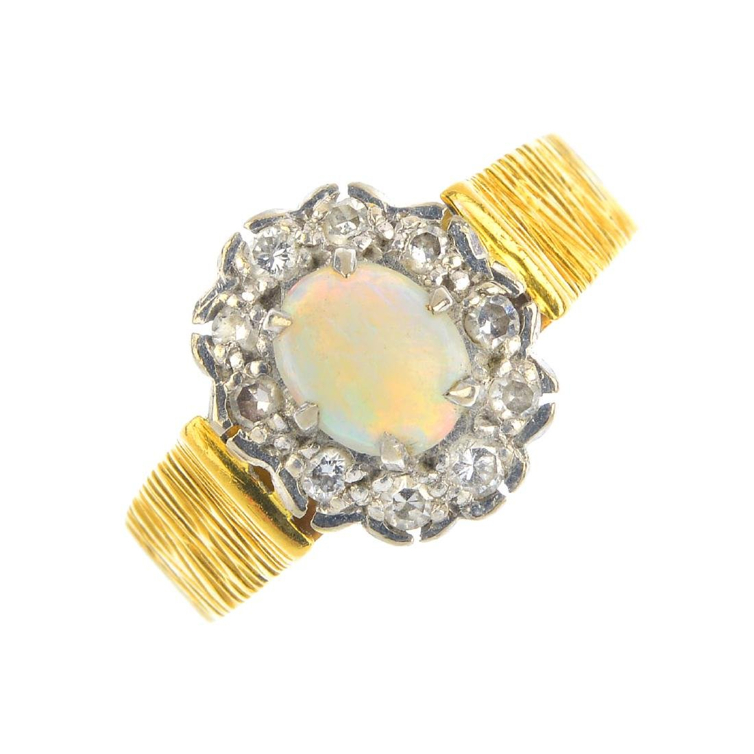 An 18ct gold opal and diamond cluster ring. The oval