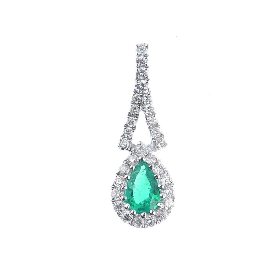 An emerald and diamond pendant. The pear-shape emerald,