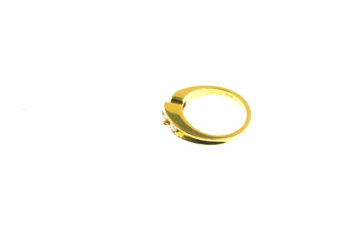 An 18ct gold diamond three-stone ring. The graduated - 2