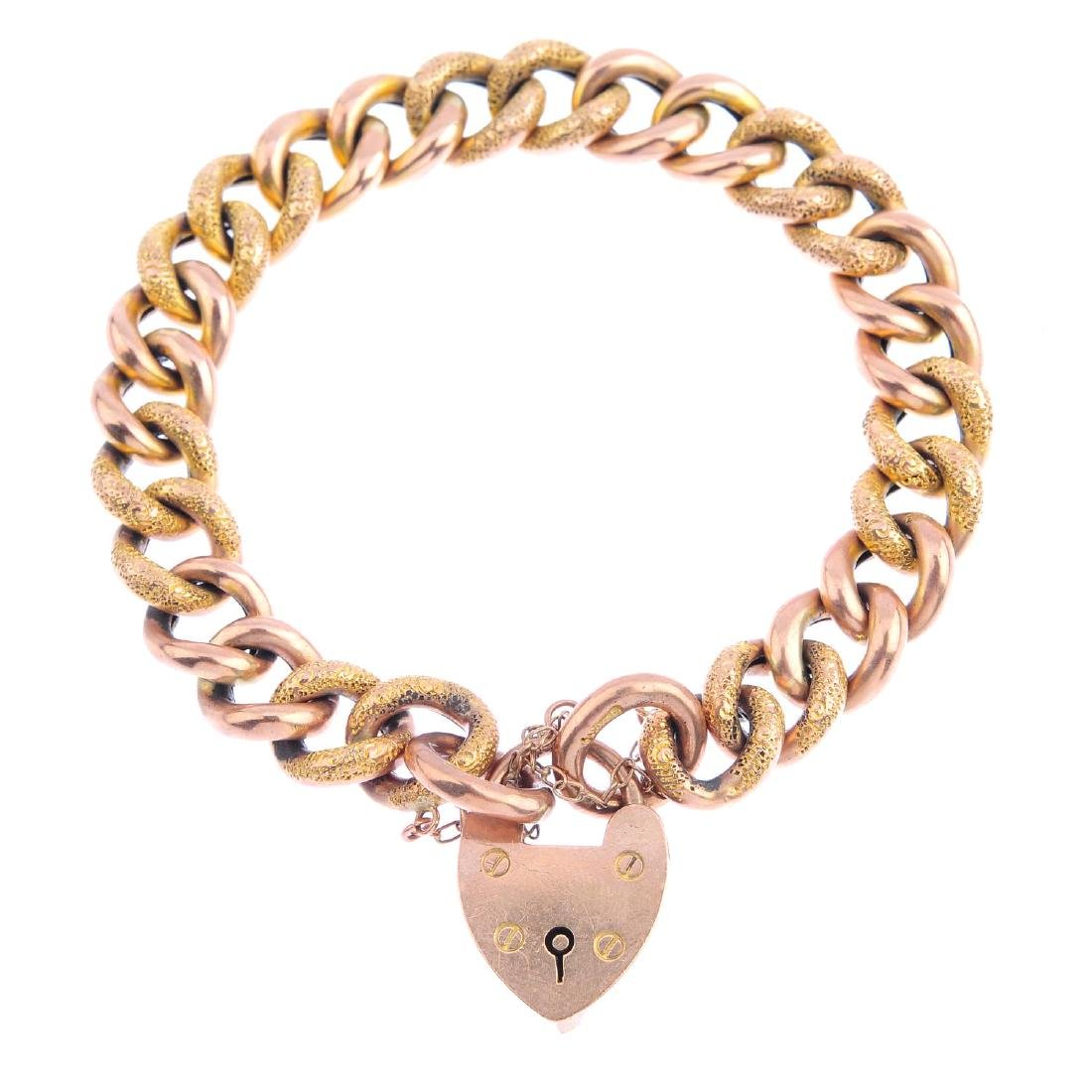 A late Victorian 9ct gold bracelet. The curb-link