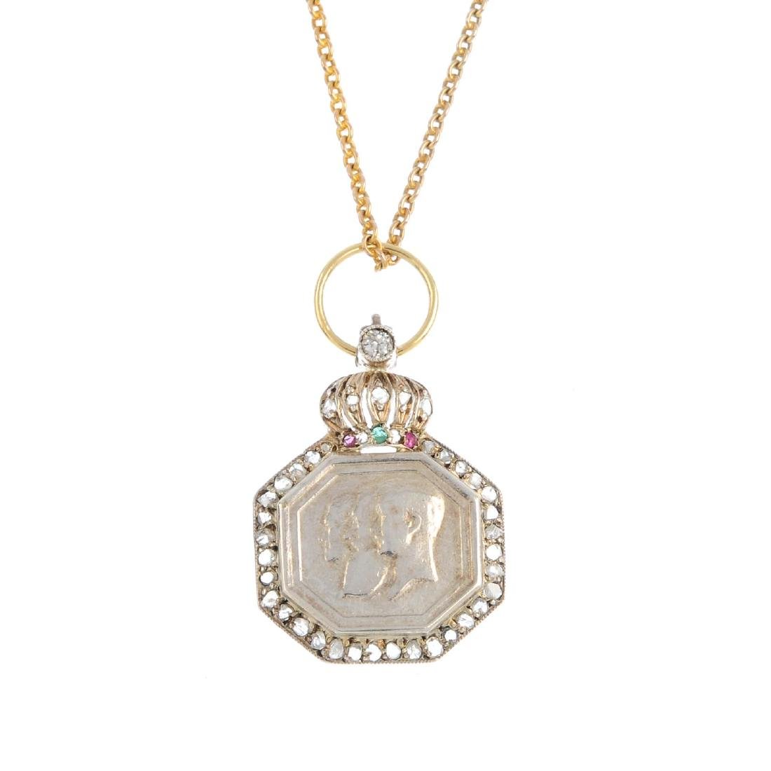 A gem-set miniature medal pendant. Depicting the