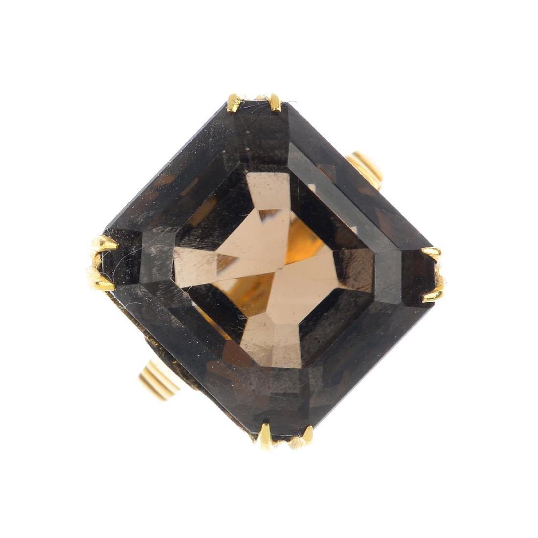 A smoky quartz dress ring. The rectangular-shape smoky