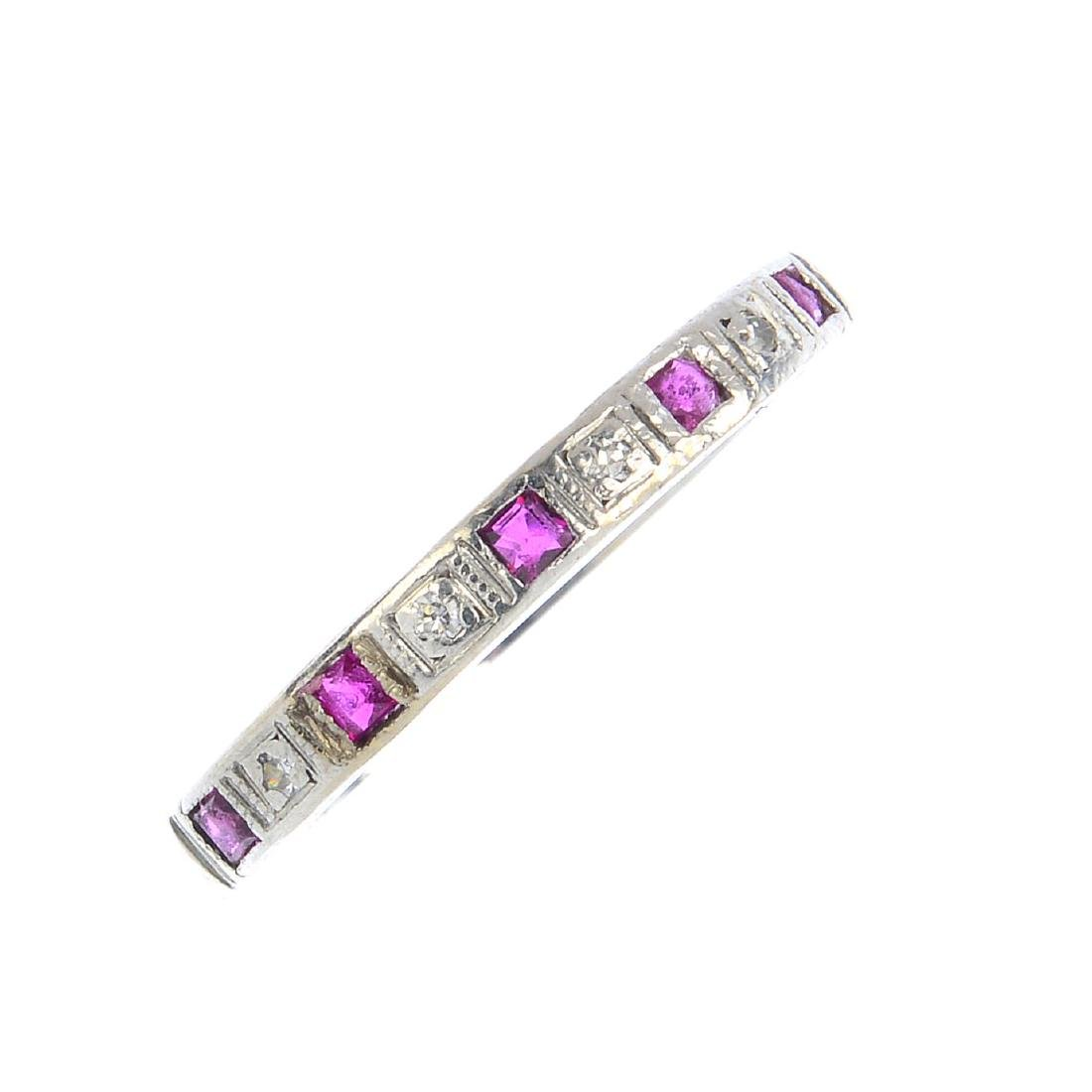 A ruby and diamond half eternity ring. The alternating