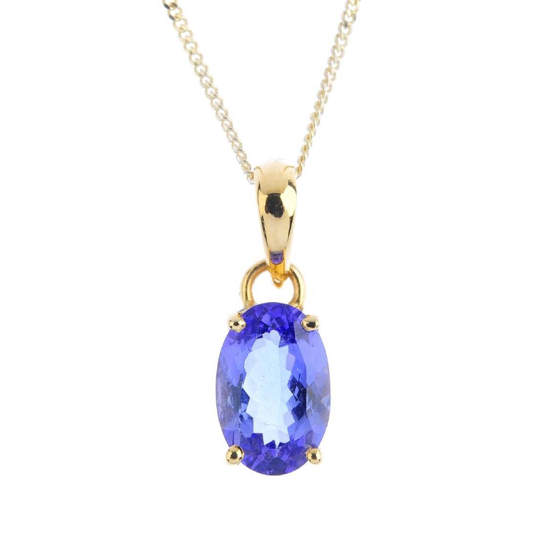 A tanzanite pendant. The oval-shape tanzanite, with