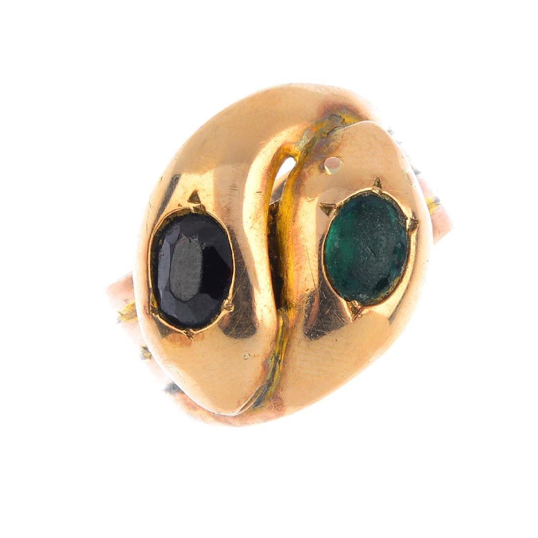 A late Victorian 9ct gold gem-set snake ring. Designed